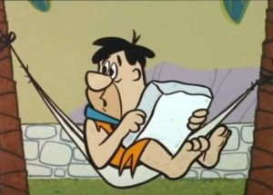 Fred Flinstone reads stories.